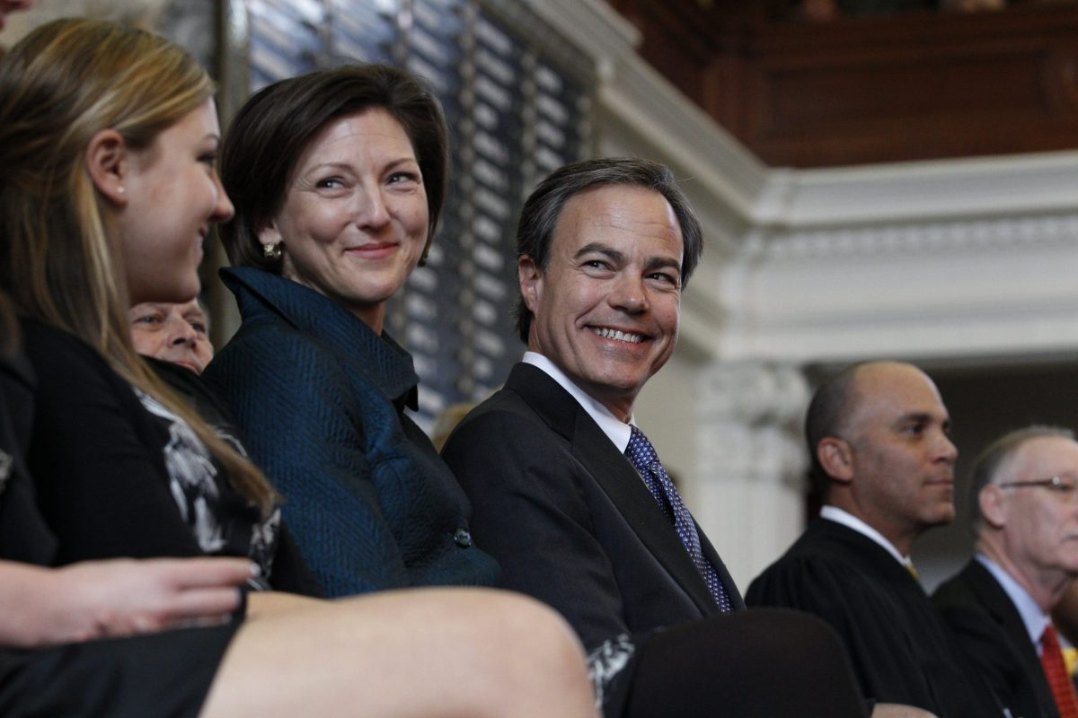 Joe Straus of San Antonio smiles after being elected Speaker of the House for the second consecutive session as the upcoming 82nd Legislative session gets underway. Texas has weathered the economic crisis better than most states but still faces a potential $27-billion shortfall in the next fiscal year. Next to Straus is his wife Julie.