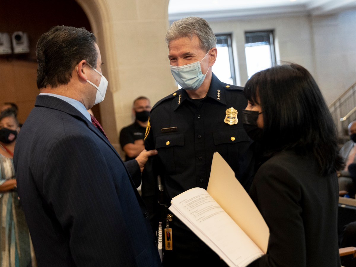 City Manager Erik Walsh, left, meets with San Antonio Police Chief William McManus and Deputy City Manager Maria Villa Gomez.