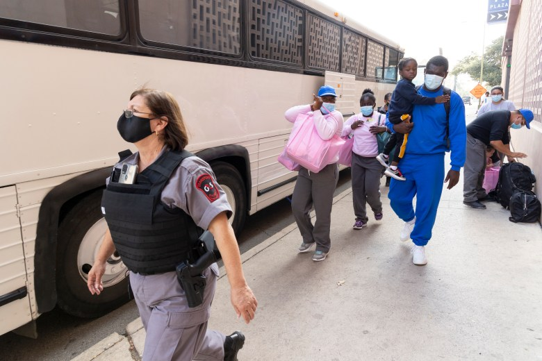 Haitian migrants arrive to downtown San Antonio and the Greyhound bus station on Tuesday morning.  The man in blue gave his name as Jerry and said his family traveled from Haiti by way of Del Rio.