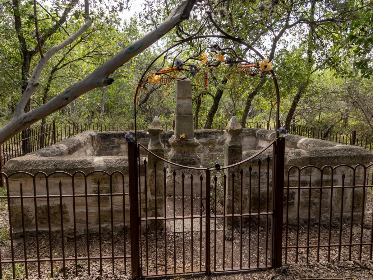 The Huebner-Onion Natural Area greets visitors with a gated gravesite of Joseph Huebner.
