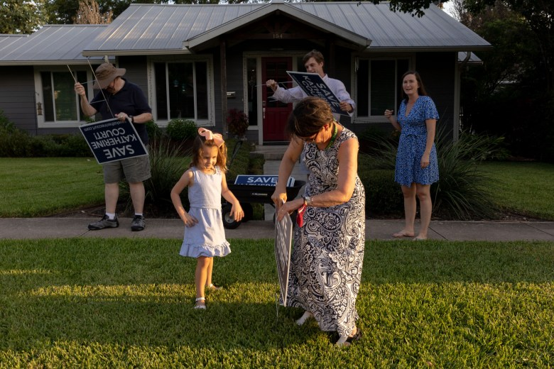 Neighbors of Katherine Court put out yard signs along the Alamo Heights residential street opposing a housing development that would encompass three lots.