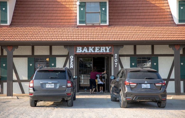 Customers enter Haby's Alsatian Bakery on Friday.