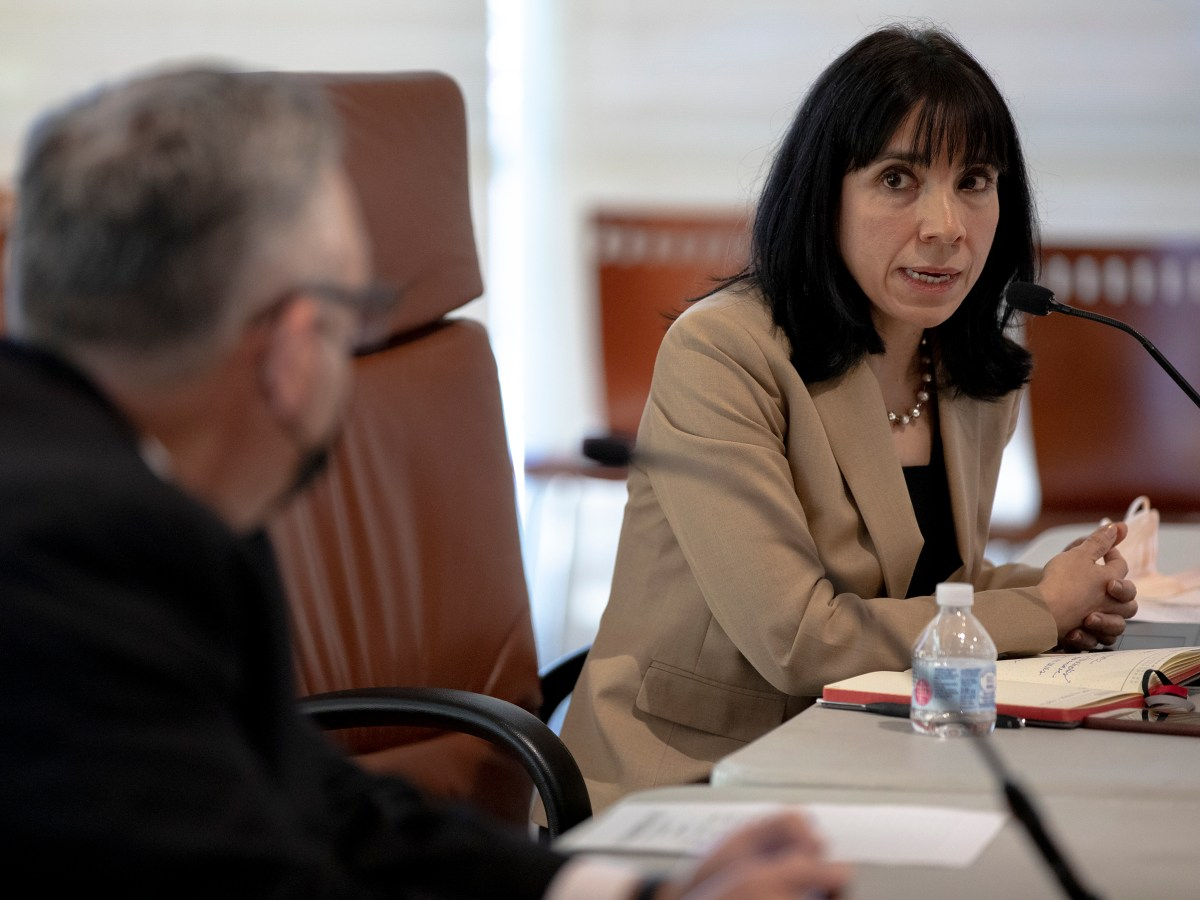 Maria Villagómez, deputy city manager, speaks to Christopher Lutton, chair of the union negotiations committee, during collective bargaining negotiations between the City and police union on Thursday.