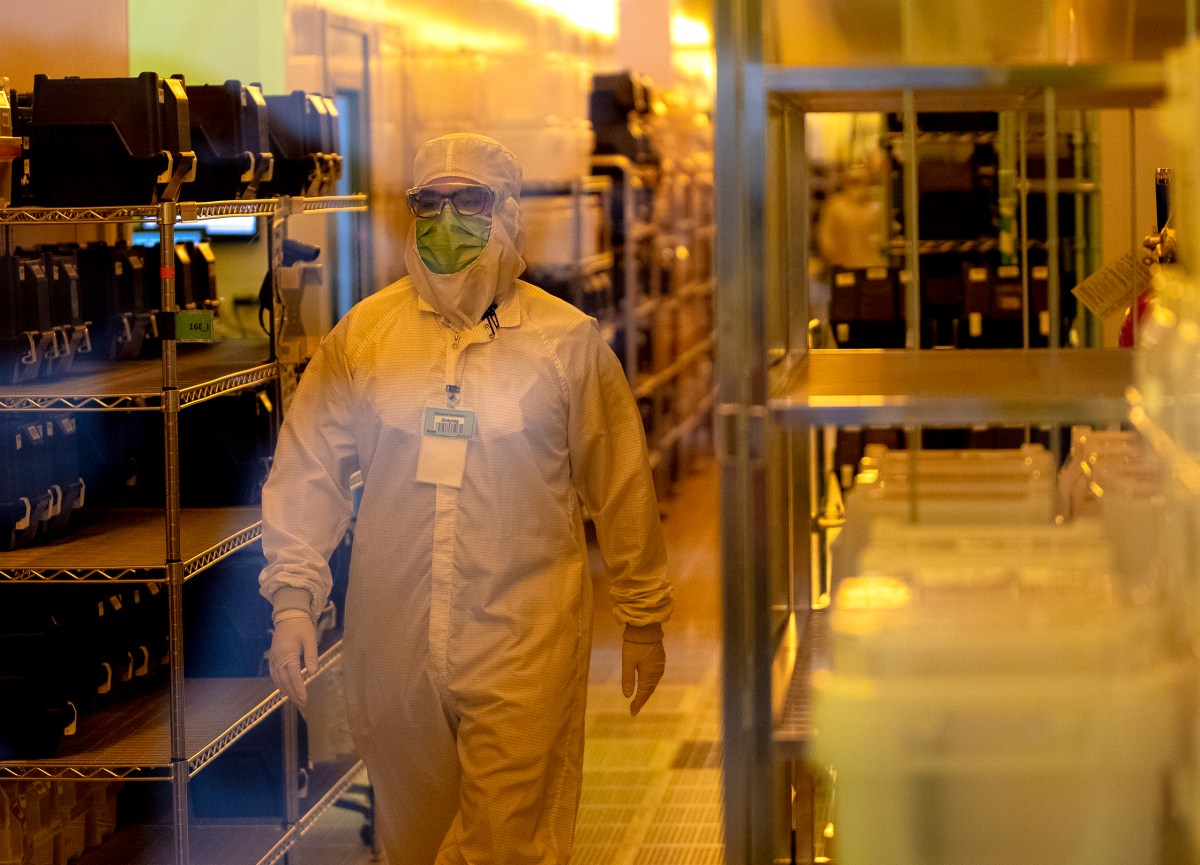 Employees of Tower Semiconductor produce chips at the company's San Antonio headquarters on Tuesday.
