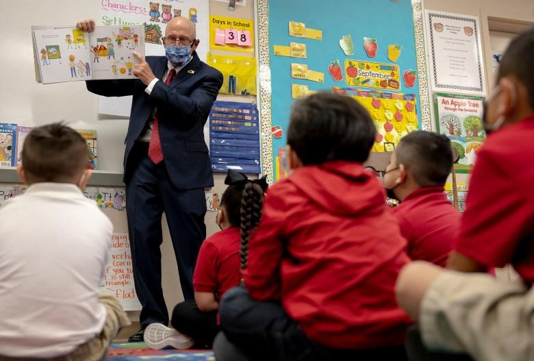 Dr. Robert Jaklich, SAISD's interim superintendent, reads a book to kindergartners at Wilson Elementary on Thursday.
