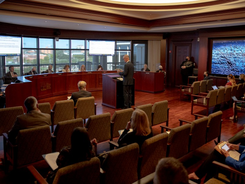 A staff member presents an item to board members during a San Antonio Water System board meeting on Tuesday.