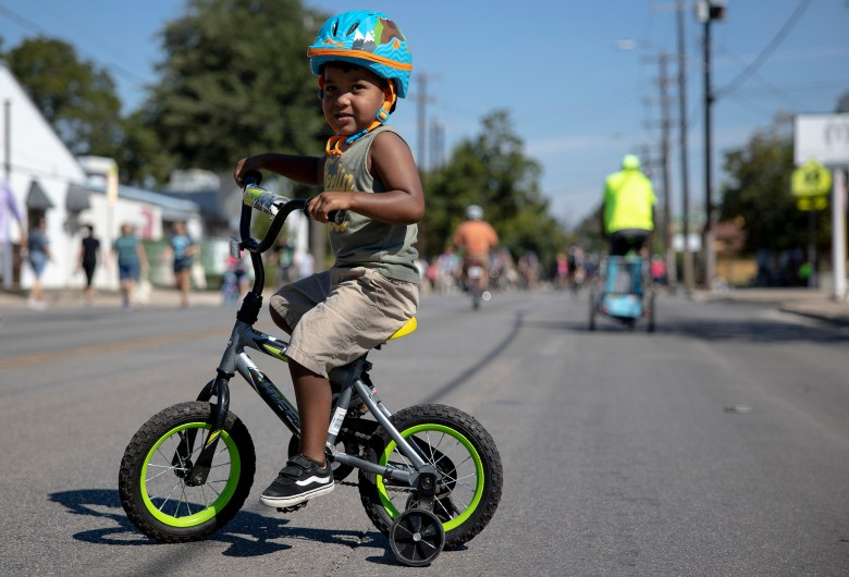 Jaxon Quintanilla rides his bike Sunday during Síclovía, the YMCA's biannual event that turns city streets into a safe place for families and friends to exercise and play.