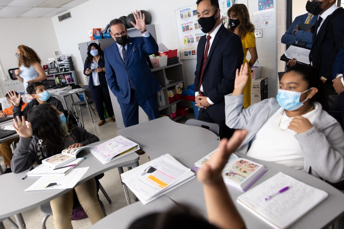 U.S. Secretary of Education Miguel Cardona asks how many of the students in class at Gus Garcia University School speak Spanish.