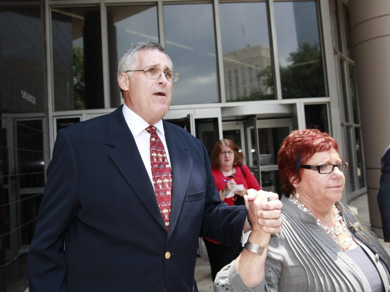 U.S. District Judge Samuel B. Kent leaves the Bob Casey Federal Courthouse holding the hand of his wife in Houston, Texas, U.S., on Monday, May 11, 2009. Kent was sentenced to 33 months in federal prison after pleading guilty to obstructing a judicial panel's investigation of charges he sexually assaulted two female employees.