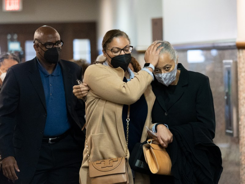 Linda Collier Mason, right, is escorted out of the courtroom by friends and family following her sentencing of the death of Tito Bradshaw in April, 2019.