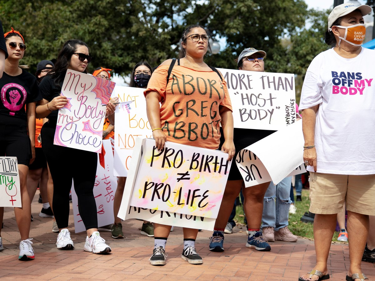 People listen to a speaker during a protest against Senate Bill 8, Texas' new restrictive abortion law, on Saturday.
