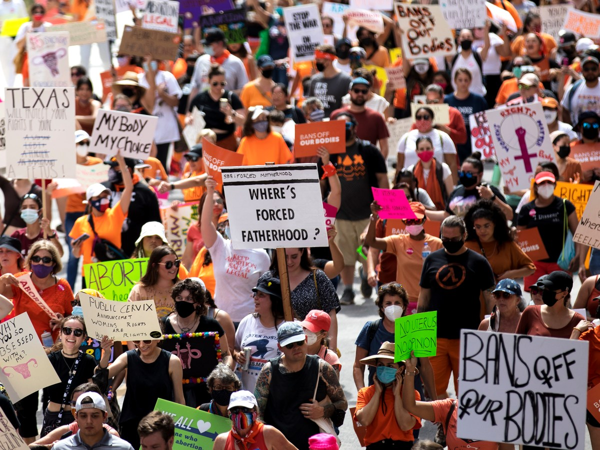 Thousands of protesters march through downtown in protest of Senate Bill 8, Texas' new restrictive abortion law, on Saturday.