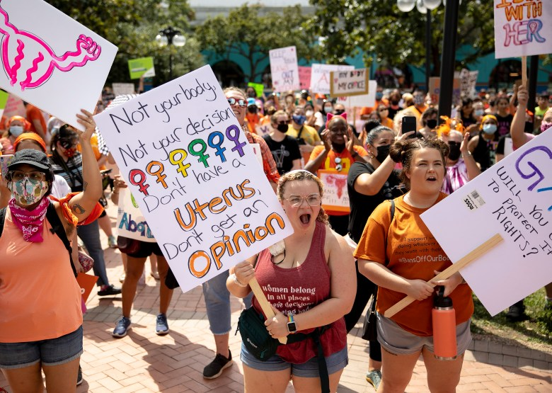Protesters cheer during a protest against Senate Bill 8, Texas' new restrictive abortion law, on Saturday.