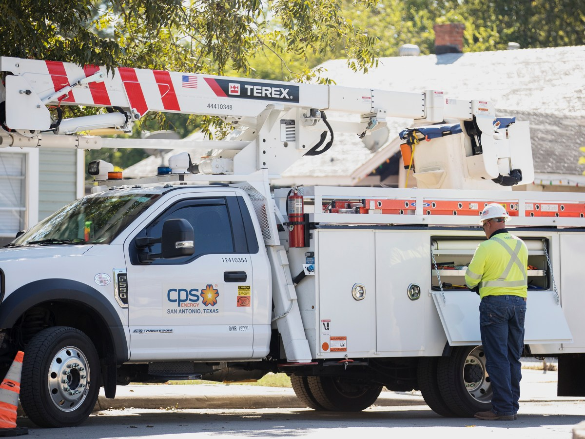 A CPS Energy worker tends to a power outage in South San Antonio on Friday.