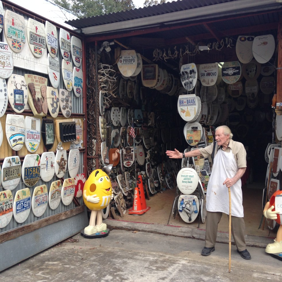 Photo of Folk Artist Barney Smith outside of his Toilet Seat Art Museum.