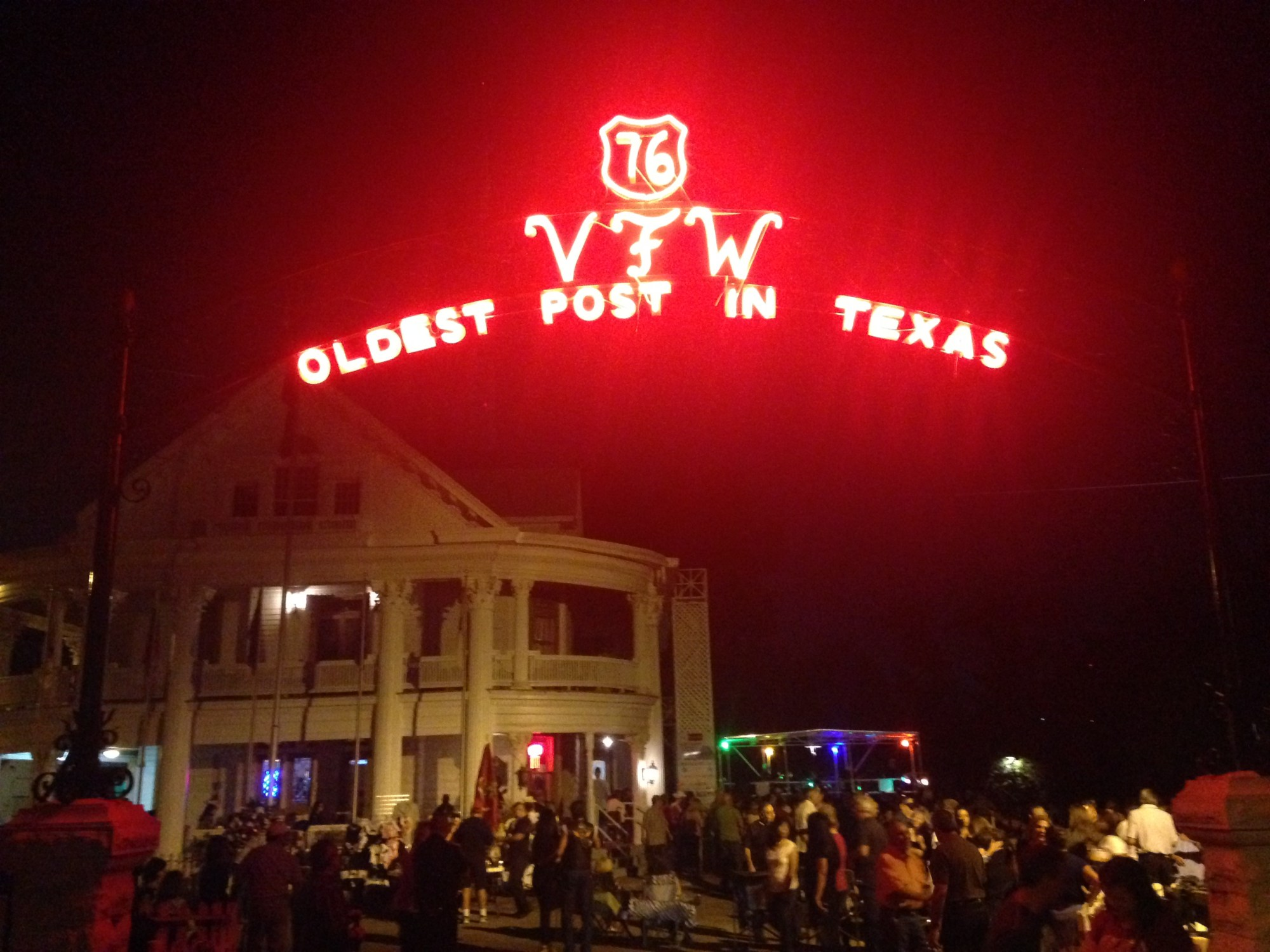 Photo of the neon sign outside of the VFW Post 74, the oldest post in Texas.