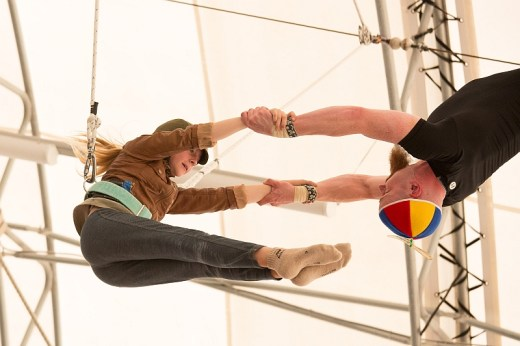 Carolyn Randles, as Amelia Earhart in the 2015 summer Fly Show, is caught by Tom Hanna.
