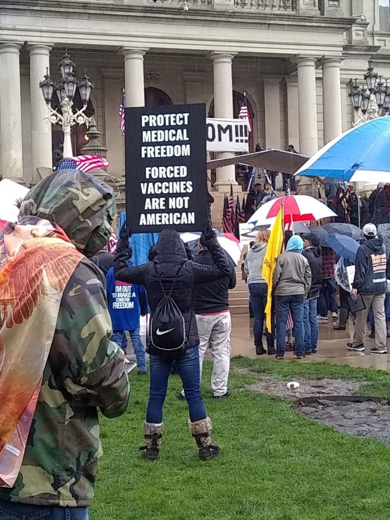 "People take part in a protest for Michiganders Against Excessive Quarantine at the Capitol in Lansing, Mich., on May 14,2020, ""Stand Up Michigan"" sponsored this event. photo/video courtesy Bobby Powell, Michigan."
