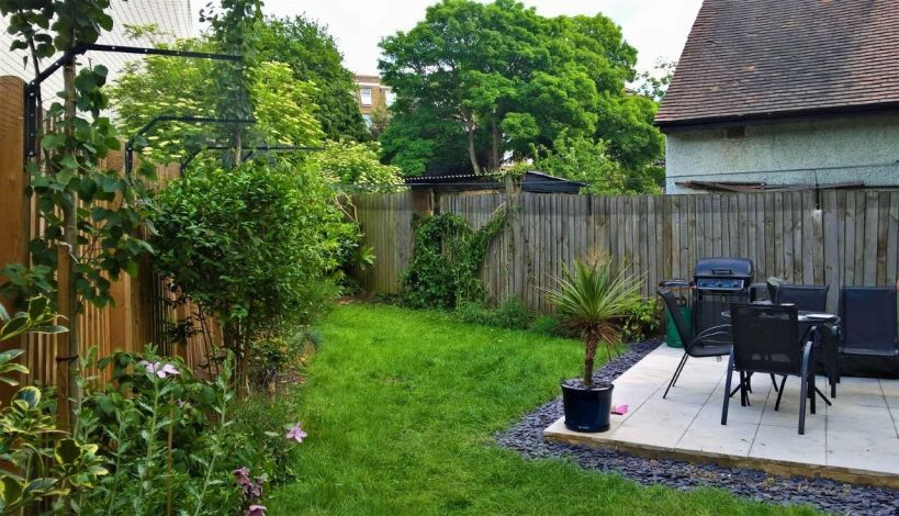 Cat safe garden with cat proof fence barriers