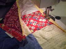 Stitching the binding.