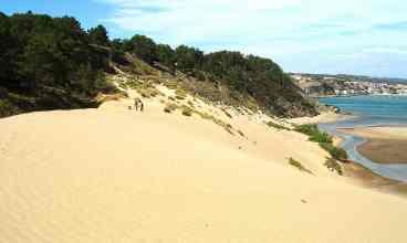 Sand surfing at the huge sand dune at Salir do Porto
