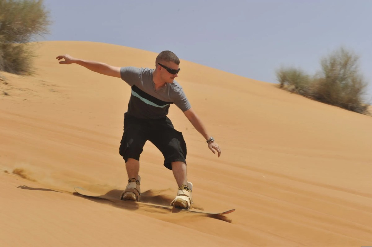 Sand surfing in the Dubai desert