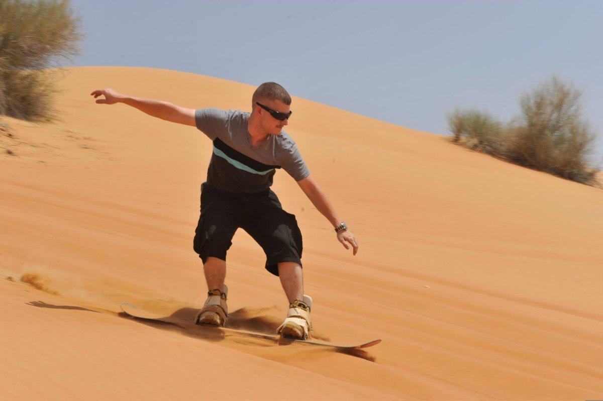 Sand surfing in the Dubai desert