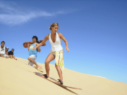 Woman sand surfing