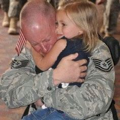 air force dad hugging daughter
