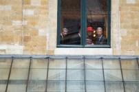 Royals peek through a window