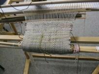 Nancy worked on a scarf on her rigid headle loom