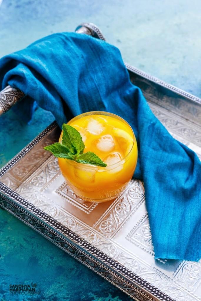 A serving glass of Mango Lemonade drink