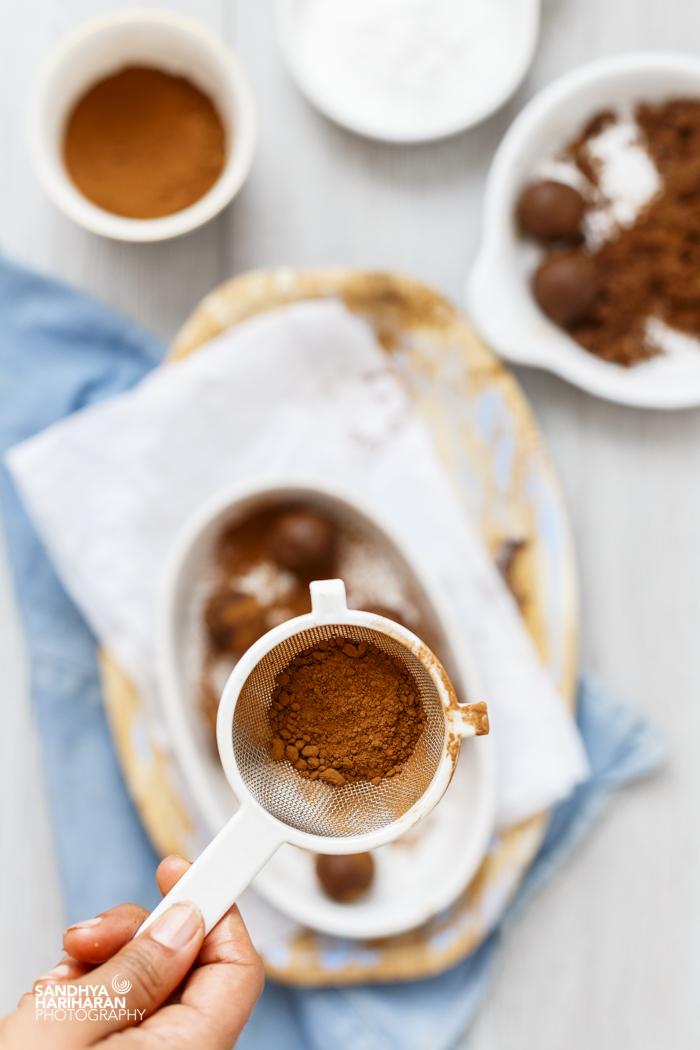 cocoa powder in a white sift