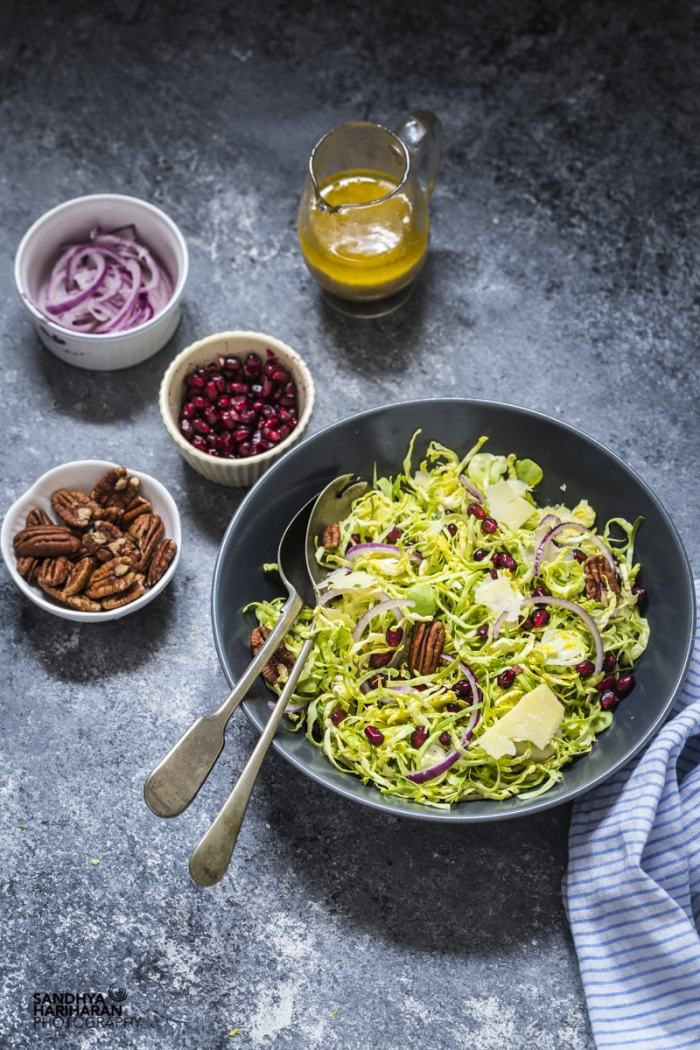 Shredded Brussel Sprouts with Lemon Vinaigrette in a bowl