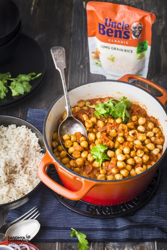 Orange Cast iron filled with Easy Indian Chana Masala