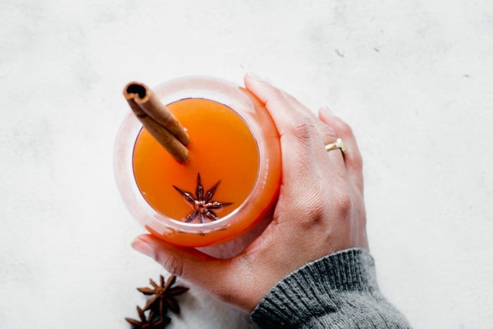 lady holding the holiday drink
