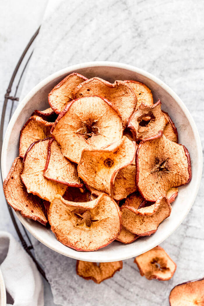 Air fryer apple chips served in a bowl
