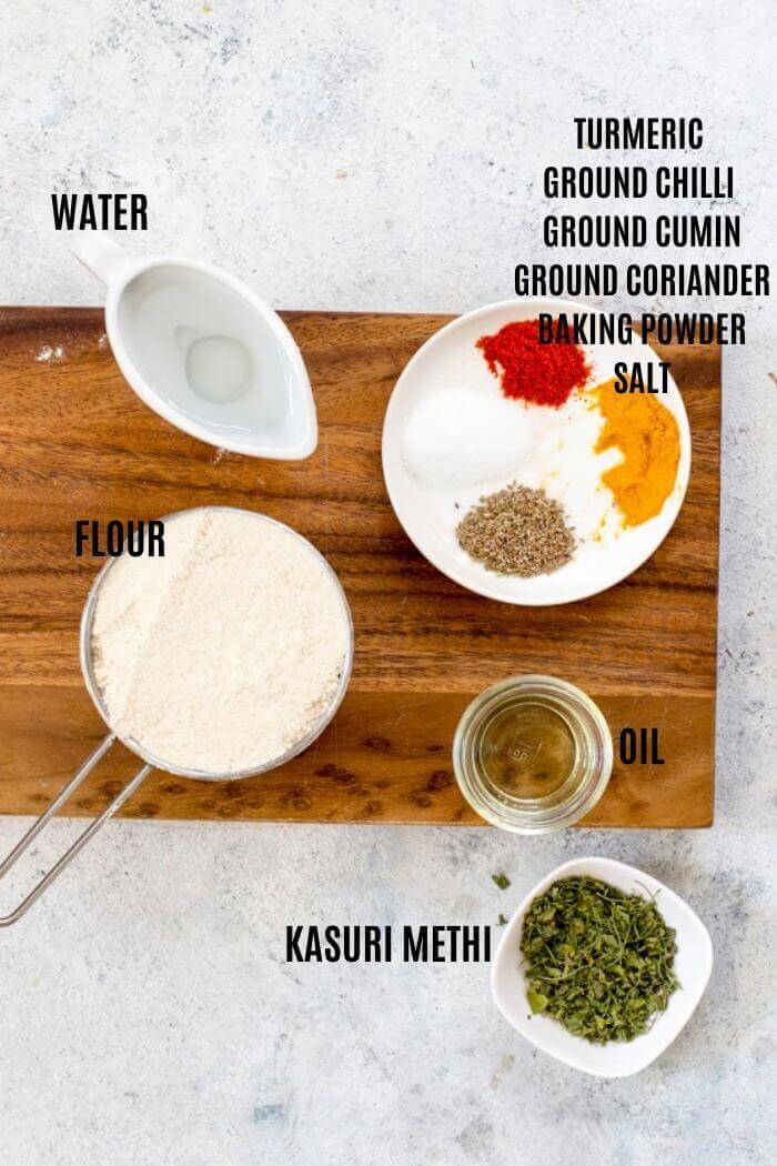 Ingredients for Mathri on a wooden board