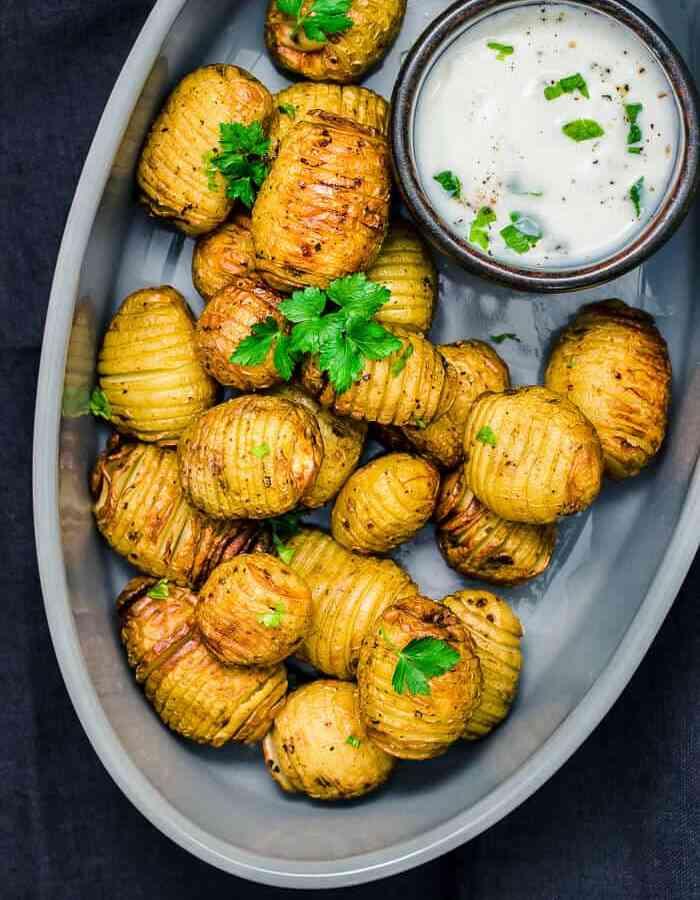 mini hasselback potato in serving dish