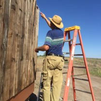 "Dave Mainz aka ""Thin Set"" applying weather coating to bird blind."
