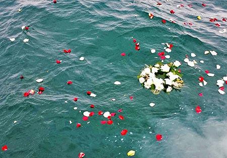 ash scattering flowers in ocean