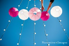 san-diego-setting-up-market-lights-with-paper-lanterns-for-wedding-reception