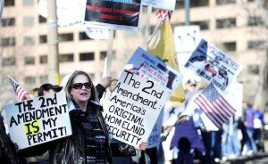 Karen Murry of Parker, Colorado, stands outside the Colorado State Capital Building during an anti-gun control legislation rally organized by Guns for Everyone in Denver