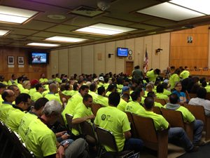 Paid employees of industry  in council chambers.