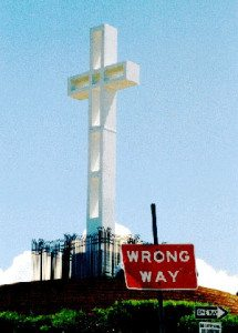 "Soledad Cross with ""Wrong Way"" sign"