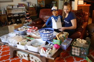 The Phillips' coffee table turns into a Wyatt's Wish assembly line when Wyatt and his mother, Beth, get ready to fill care packages with supplies.