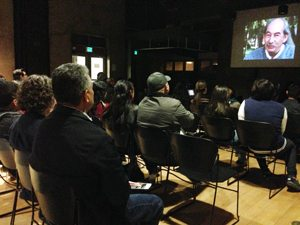Attendees of the Enero Zapatista opening event watch a film at the Sherman Heights Community Center.
