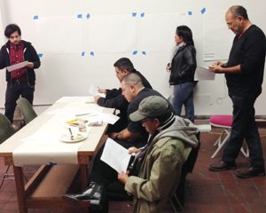 Open Spaces coordinators (standing from left to right) Misael Diaz, Irma Aguayo Esquivias and Roberto Salas. Barrio Logan gateway sign artist Armando Nuñez is seated in the foreground.