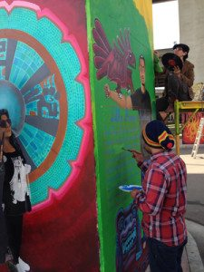 Jorge Mendoza and Jasmine Garcia painting away.