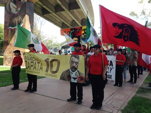 Unión del Barrio cadre standing at attention waiting for the Zapata March to begin.